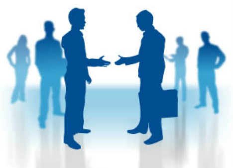 Blue silhouetted picture of businessmen shaking hands